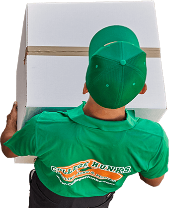 The back of a man holding a large box.