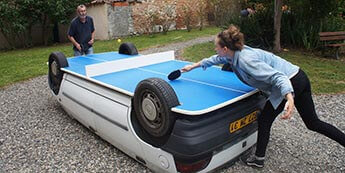 An old car converted into a ping pong table
