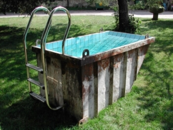 An old dumpster converted into a pool