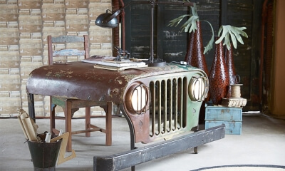 Hood of an old jeep converted into a desk