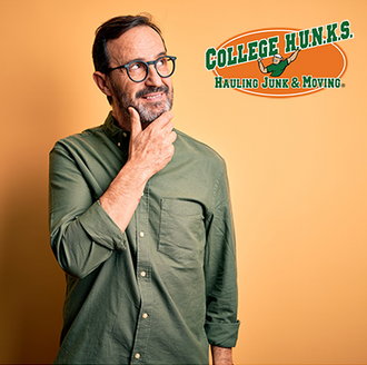 Man in a green shirt thinking about a College HUNKS franchise opportunity