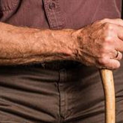 A hand holding a cane for safe support