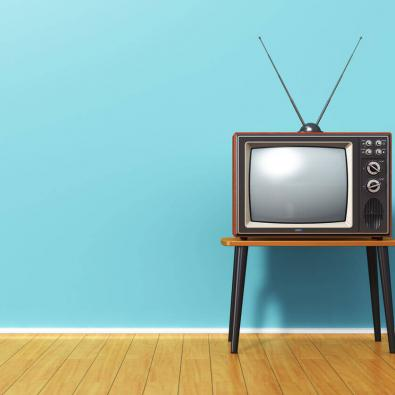 vintage-tv-against-blue-wall