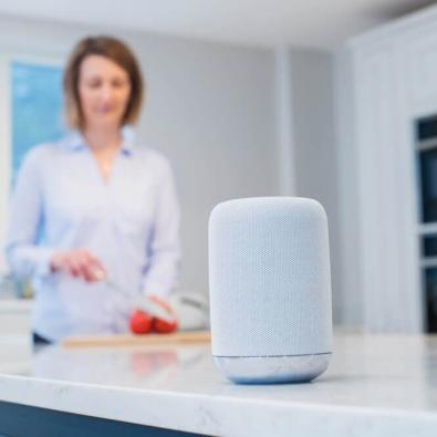 woman-with-automated-voice-speaker