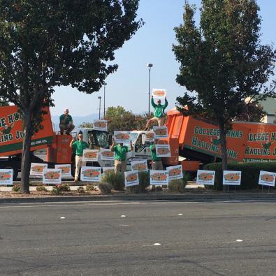 College HUNKS participate in a big truck wave