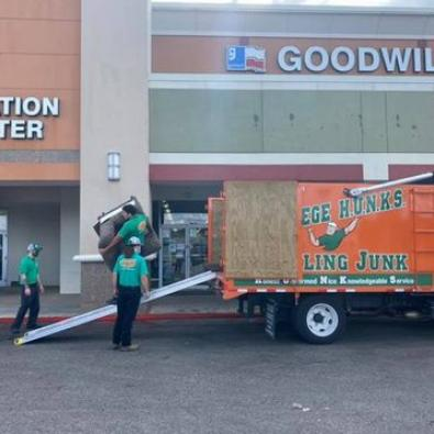 College HUNKS deliver donations to GoodWill