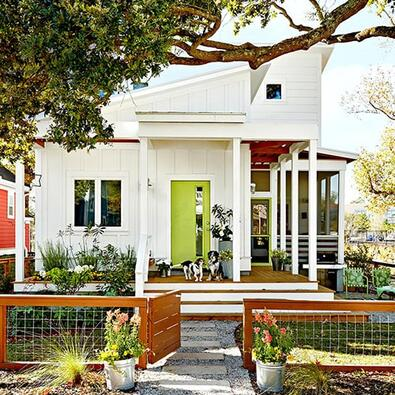 white home with green door has attractive curb appeal
