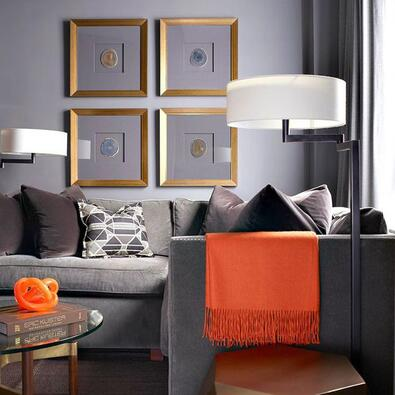 gray themed living room with orange pop of color for accent