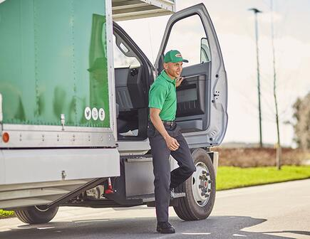 College hunk stepping out of moving truck