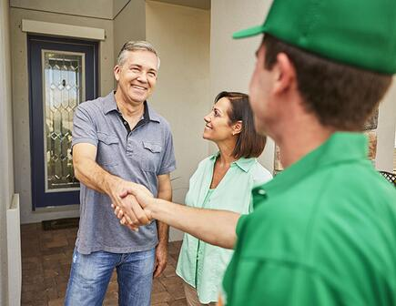 homeowner shaking hands with mover