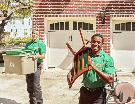 two college hunks moving household items