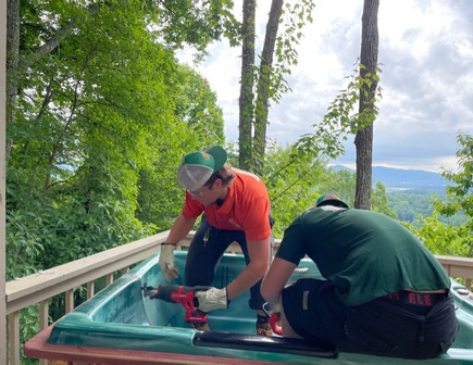 College HUNKS removes a hot tub in Asheville