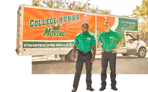 Two hunks standing in front of a moving truck