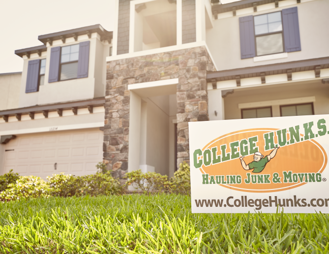 College Hunks Sign In Front of a Home