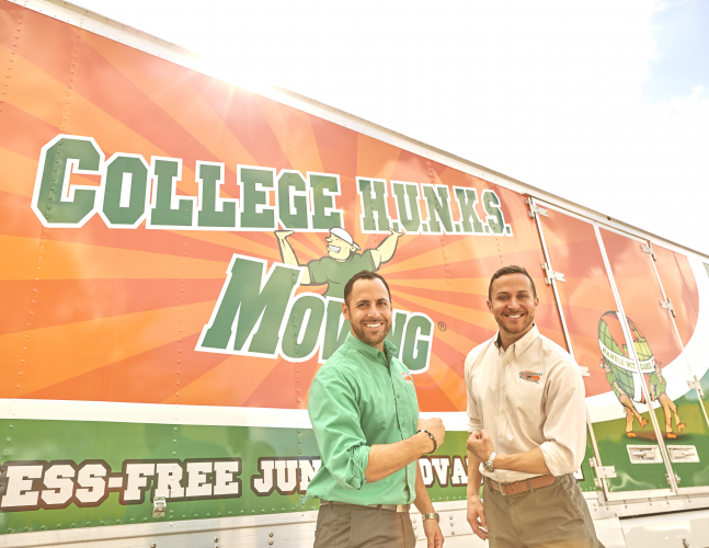 Founders Nick and Omar Standing Before a College Hunks Truck