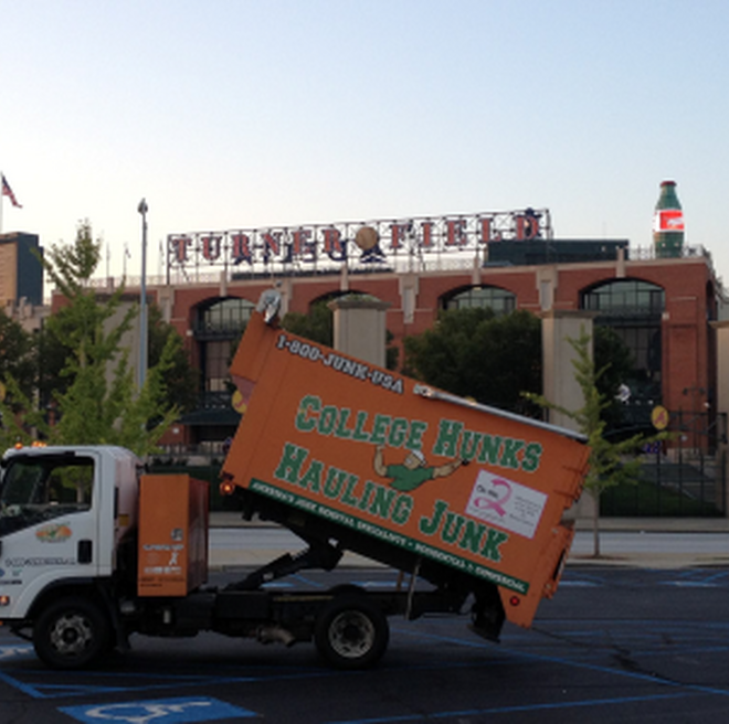 College HUNKS junk truck in front of the old Turner Field in Atlanta