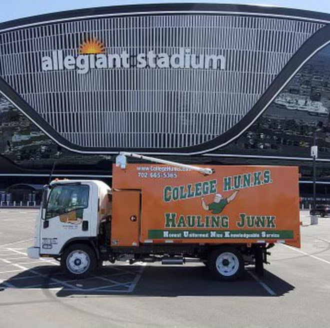 College Hunks junk removal truck parked at Allegiant Stadium