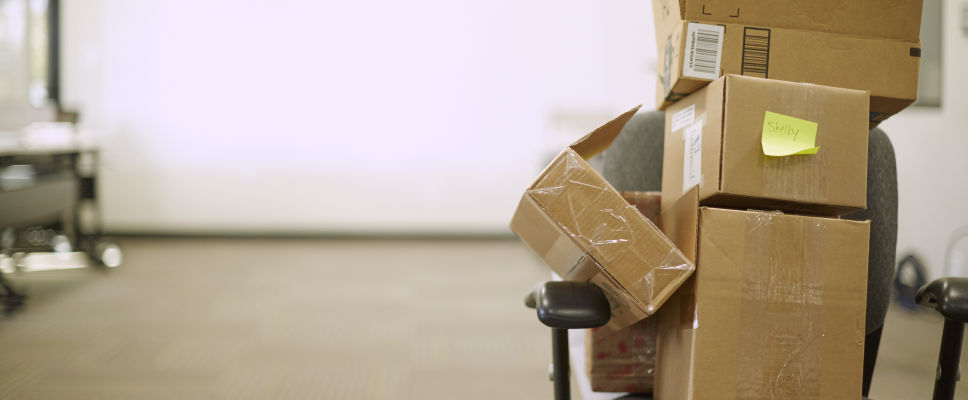 A stack of boxes on an office chair