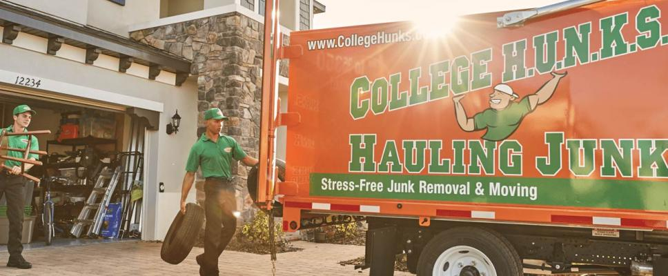 College Hunks team moving items into College Hunks truck